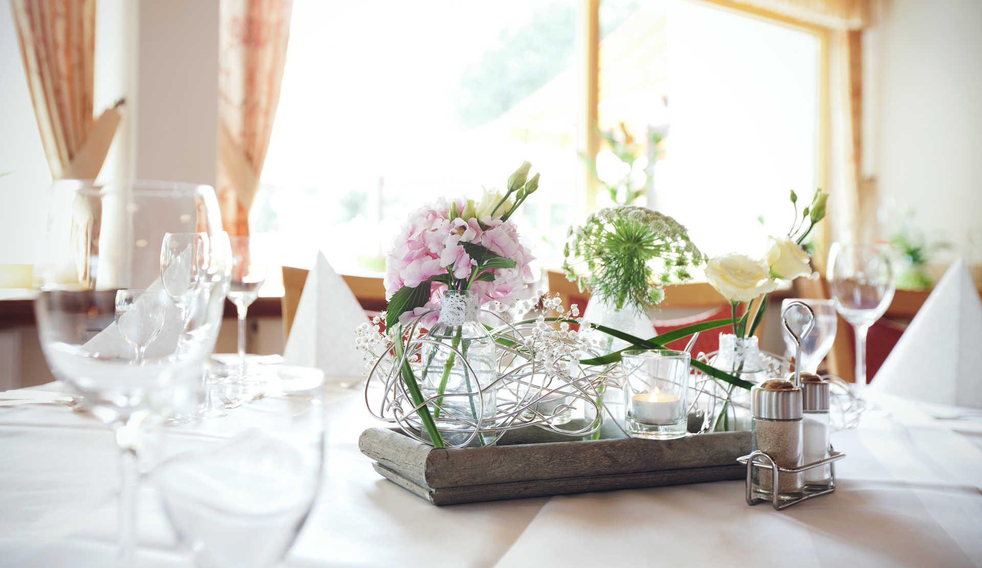 Table with wine glasses and flowers