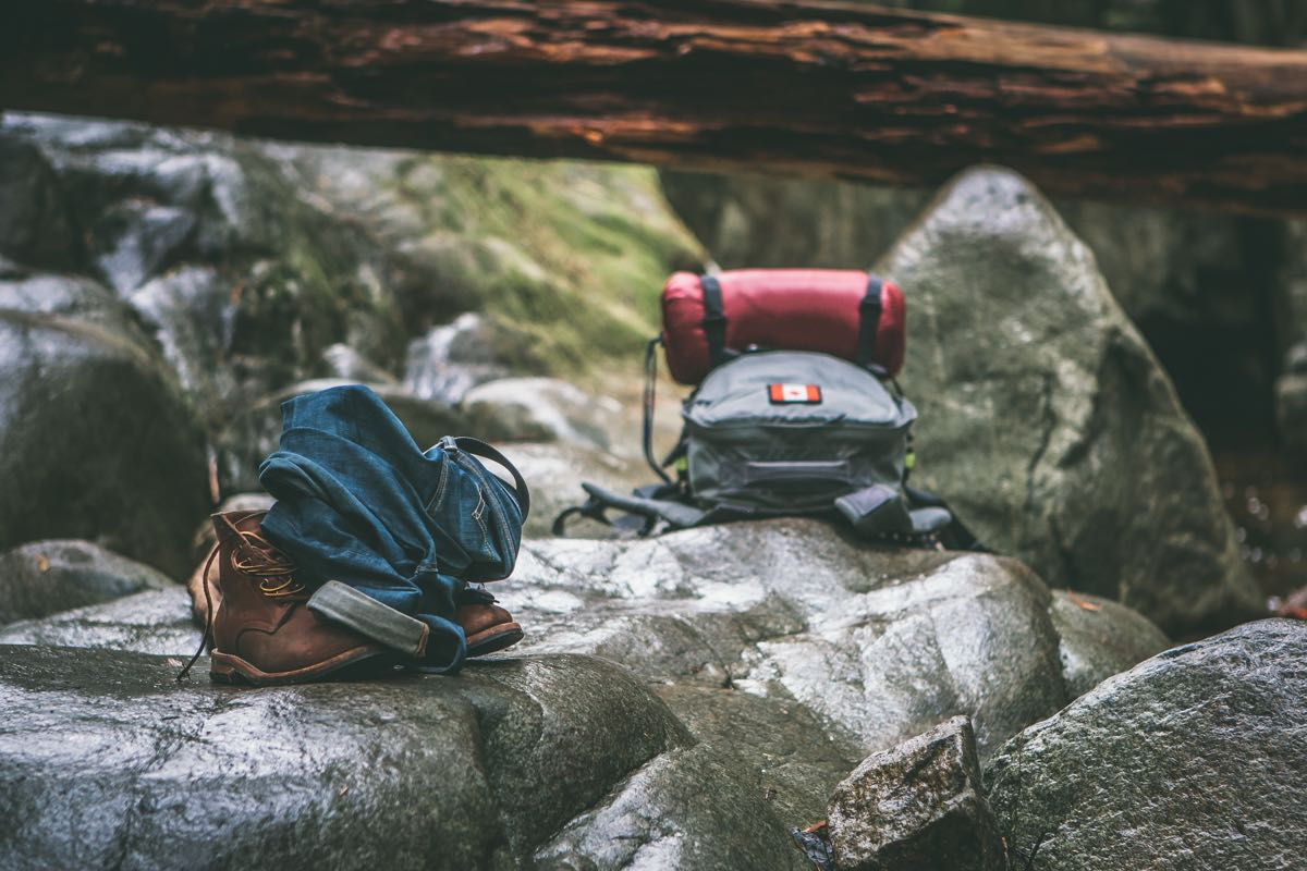 Boots and backpack on rocks