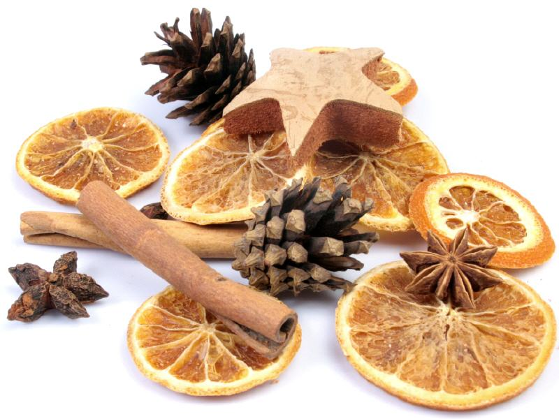 Dried orange slices, anise, pine cones, and cinamon sticks