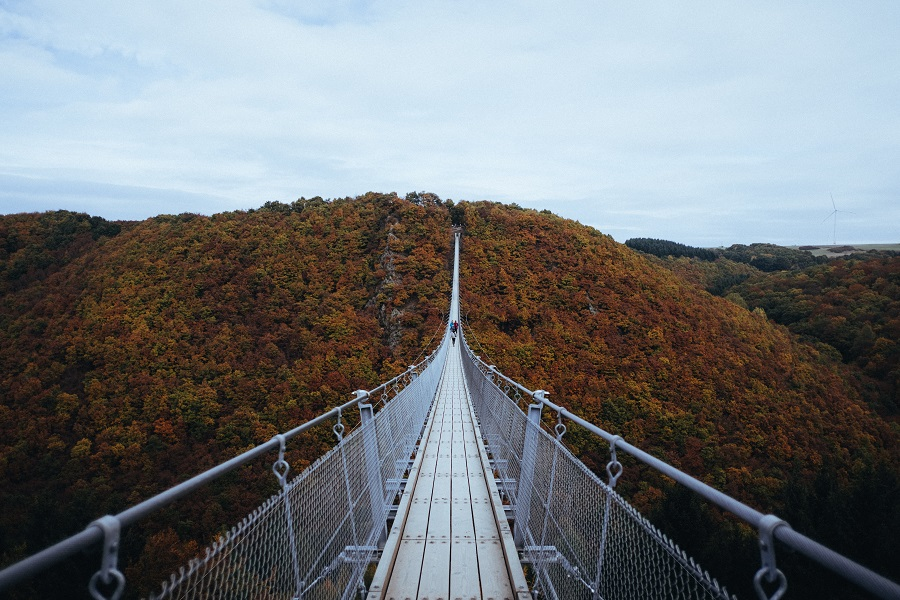 Suspension bridge in hilly landscape