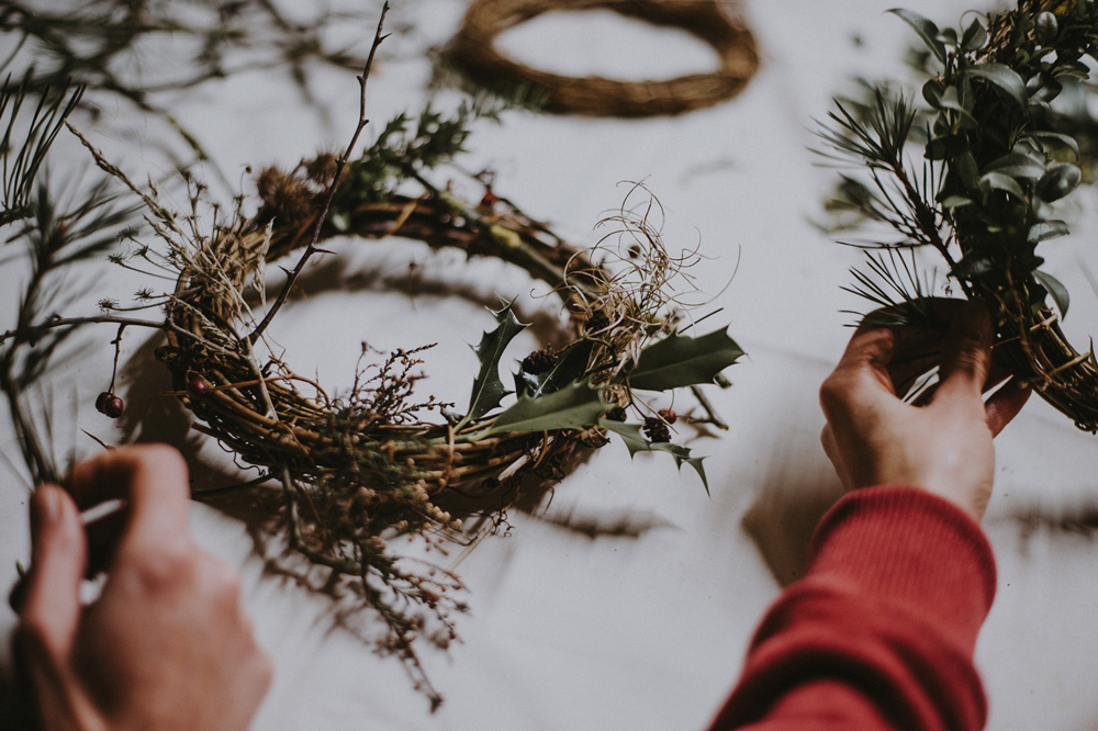 Person creating a wreath
